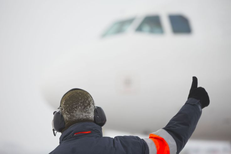 17170061 - member of ground crew is showing ok sign to pilot