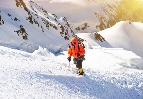47451492 - climber on the snowy mountains